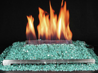 ventless gas fireplace with highly reflective colored glass fire.